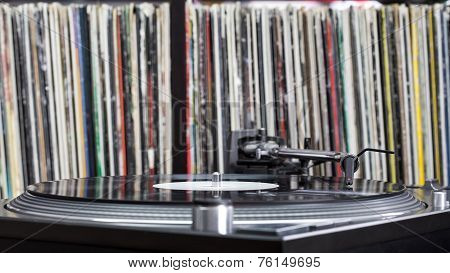 Dj Turntable On Vinyl Background