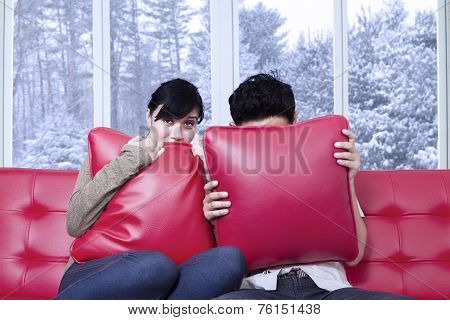 Couple Hiding On The Pillows