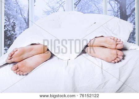 Divorced Couple Looks From Their Feet