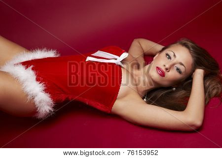 Sexy Santa Helper On Red Background