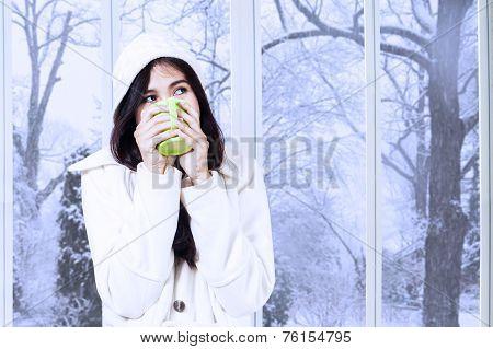 Pretty Girl Daydreaming While Enjoy Warm Drink