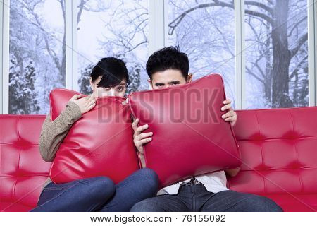 Scared Couple Watching Movie At Home