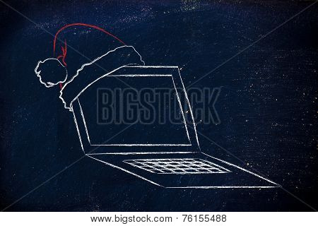 Computer With Santa Claus Hat, Concept Of Christmas Shopping Online
