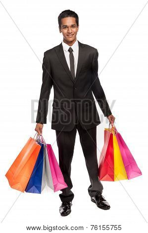 Young Mixed Race Man With Shopping Bags.