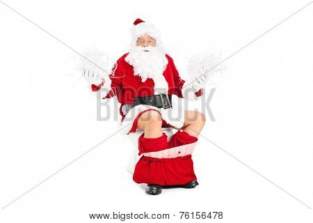 Santa holding bunch of shredded paper on a toilet isolated on white background