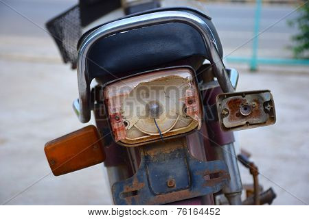 old motorcycle with broken tail light box