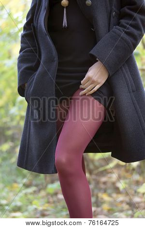 Girl In Black Coat And Red tights
