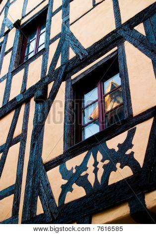 Light Orange/pink Timber Frame House In Alsace