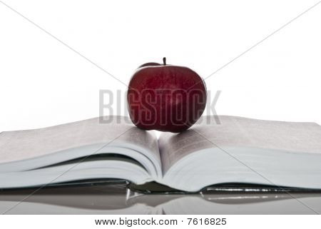 Opened Book And Red Apple