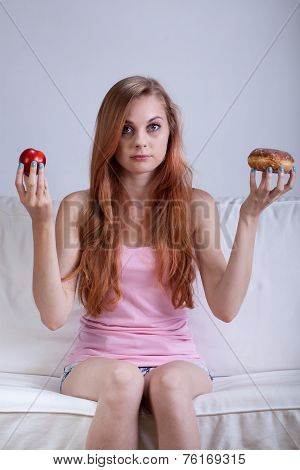 Choice Between Apple And Doughnut