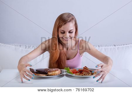 Girl Binging On Lots Of Food