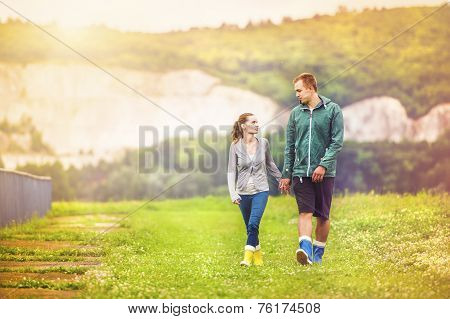 Young couple walking in muddy nature