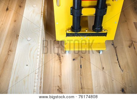 Gluing machine on wooden floor