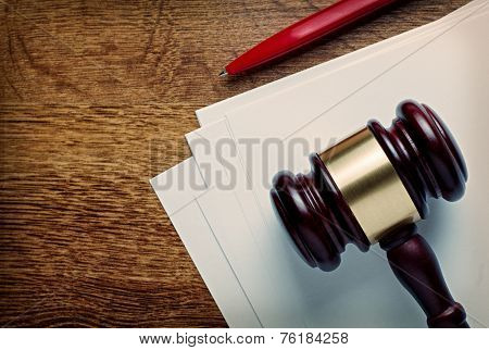 Wooden Judges Gavel And Blank Paper