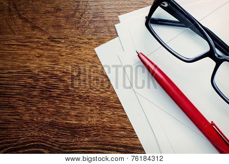 Modern Reading Glasses On Blank Paper