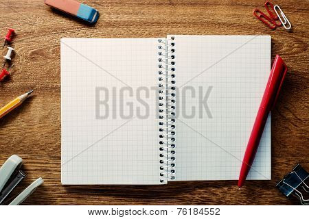 Red Pen Ready For Writing On An Open Notebook