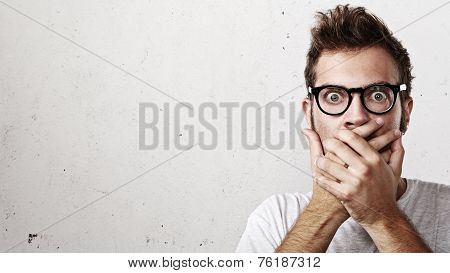 Shocked Man Covering His Mouth With Hands