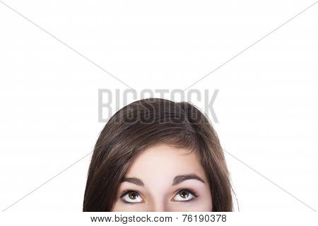 Eyes of brunette woman looking up dumbfounded isolated on white