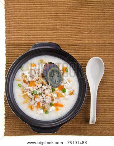 Traditional Chinese Century Egg & Pork Porridge Rice Gruel Served In Claypot