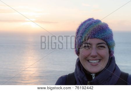 Portait Of A Smiling Woman With Woollen Hat