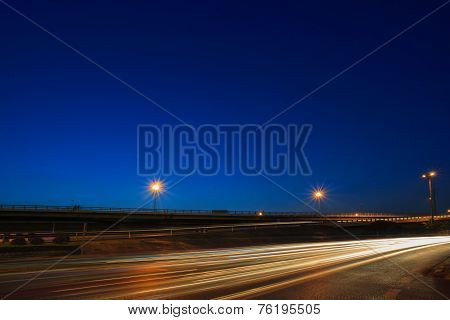 Lighting Of Vehicle Driving On Asphalt Road Against Beautiful Blue Dusky Sky In Evening Use As Land