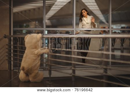 Girl Says Goodbye With A Teddy Bear.