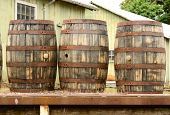 stock photo of loading dock  - Wine barrels sittng on a loading dock at a large winery and beer brewery in the Willamette Valley near Portland Oregon - JPG