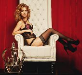 image of throne  - sensual princess woman in black lingerie sitting on throne - JPG
