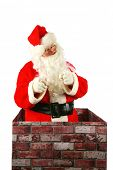 Постер, плакат: Santa Claus in a Chimney Santa Claus smiles and points to you the viewer as he enters a chimney on