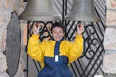 Girl chiming on the bells poster