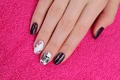 picture of nail paint  - Finger nail treatment hands with painted fingernails - JPG