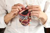 picture of knitting  - close up of woman hands knitting with knitting needles - JPG