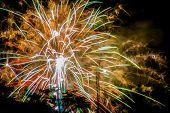 stock photo of guy fawks  - Digital illustration of colorful fireworks display on a dark background - JPG
