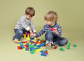 picture of playtime  - Kids children sharing playing nicely together teamwork and cooperation concept - JPG