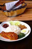 stock photo of malaysian food  - Nasi lemak traditional malaysian spicy rice dish - JPG