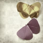 foto of kirigami  - textured old paper background with kirigami butterfly - JPG