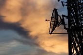 pic of pole  - Silhouette Satellite Communication Tower Poles On Evening - JPG
