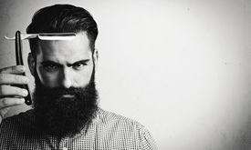 stock photo of razor  - Portrait of bearded man with vintage straight razor - JPG