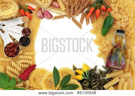 Italian pasta and mediterranean food ingredients forming an abstract border over white background.