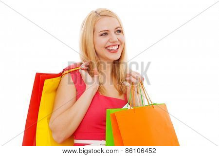 Young beautiful woman with shopping bags, white background