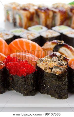 Sushi Rolls And Gunkans Over White Background
