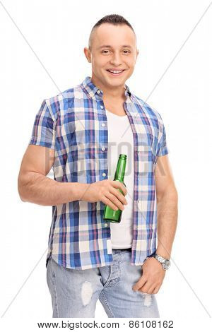 Vertical studio shot of a relaxed young man holding a bottle of beer isolated on white background
