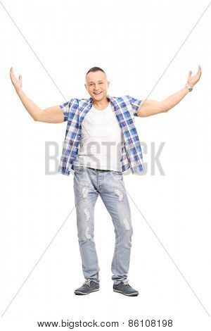 Full length portrait of a casual young man, smiling and gesturing with his hands isolated on white background