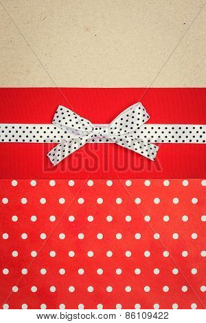 Vintage Background With Polka Dot Paper, Old Paper And Red And White Polka Dot Ribbon With Bow
