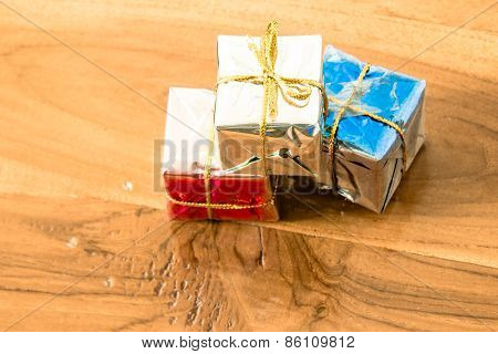 Vintage Of Gift Box On A Wooden Floor With Light Effect