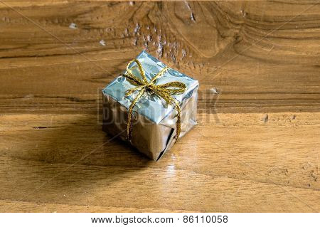 Gift Box On A Wooden Floor