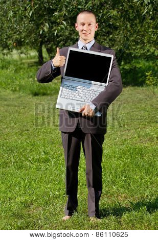 Man working outdoors as a freelancer, feels happy and shows well done