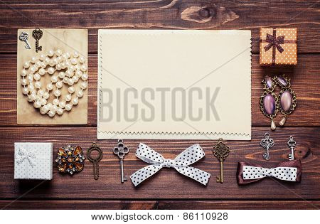 Old Paper Sheets Surrounded By Retro Objects On Wooden Background