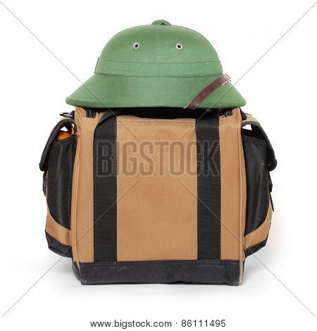 Retro travel bag and tropical hat.