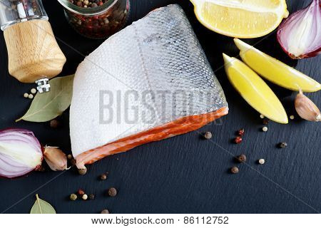 Steak Salmon With Spices And Lemon On Slate